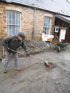 Dave removing mud from the entrance